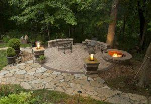 stone patio with stone fire pits