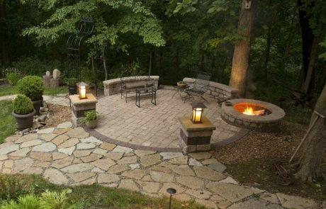 stone patio with stone firepit