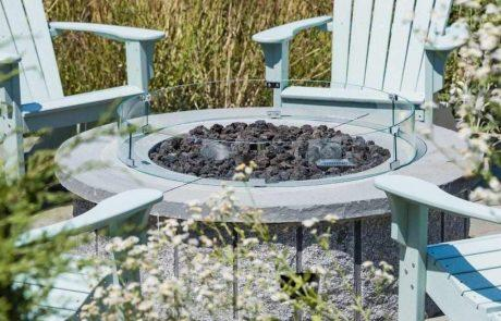 round fire pit with glass around it