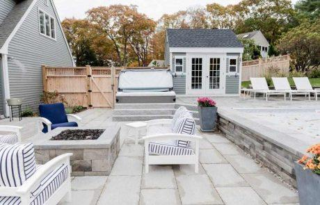 custom square stone fire pit on a patio
