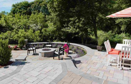 stone patio with seating area and fire pit