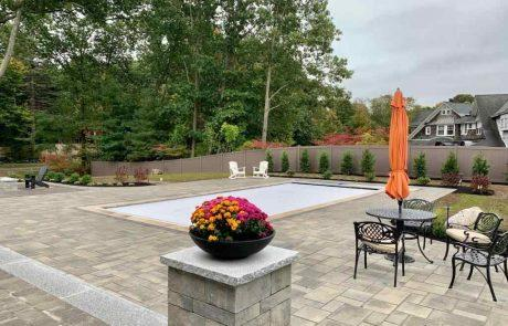pool with stone patio
