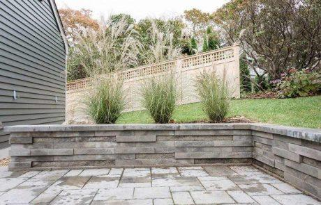stone retaining wall with grasses