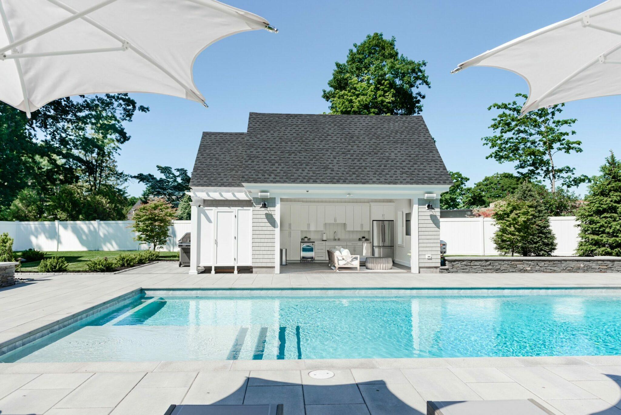 inground pool with pool house